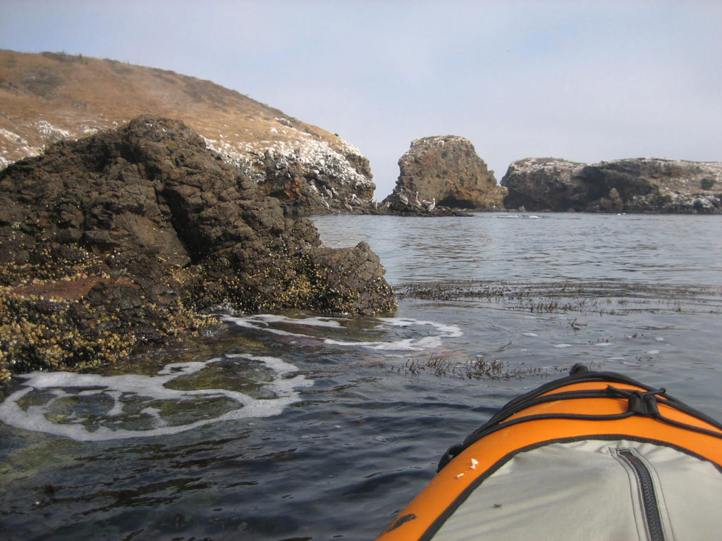 Kayaking at Little Scorpion, Santa Cruz, Channel Islands, California.