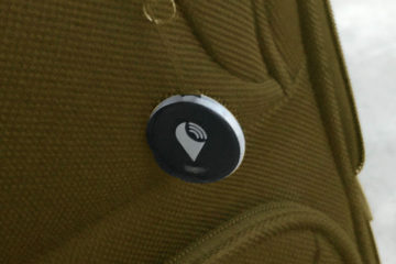 A Trackr locator fob attached to a suitcase