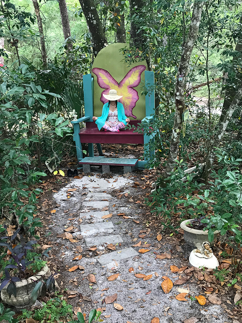 Pixie in the fairy chair at Cassadaga