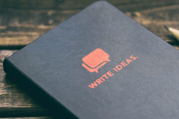 "Black book with ""Write Ideas"" on the cover"